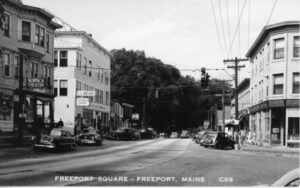 Postcard of Freeport Square showing Nordica Theater & LL Bean and automobiles.
