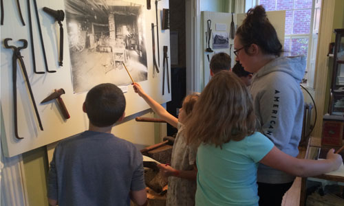 Kids looking at historical exhibits